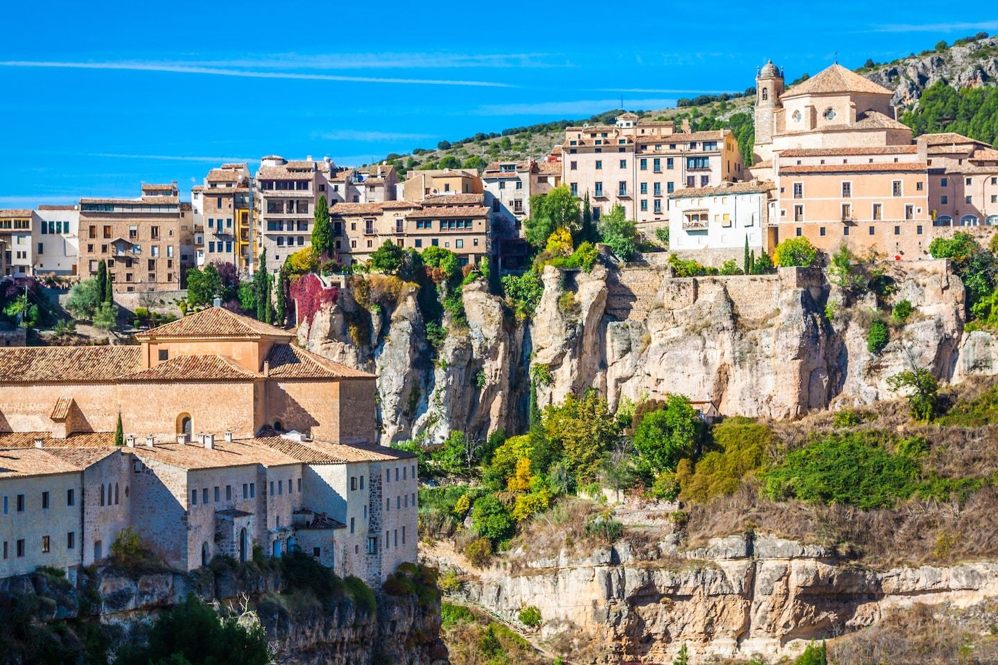 hanging houses on the side of a cliff in cuenca spain