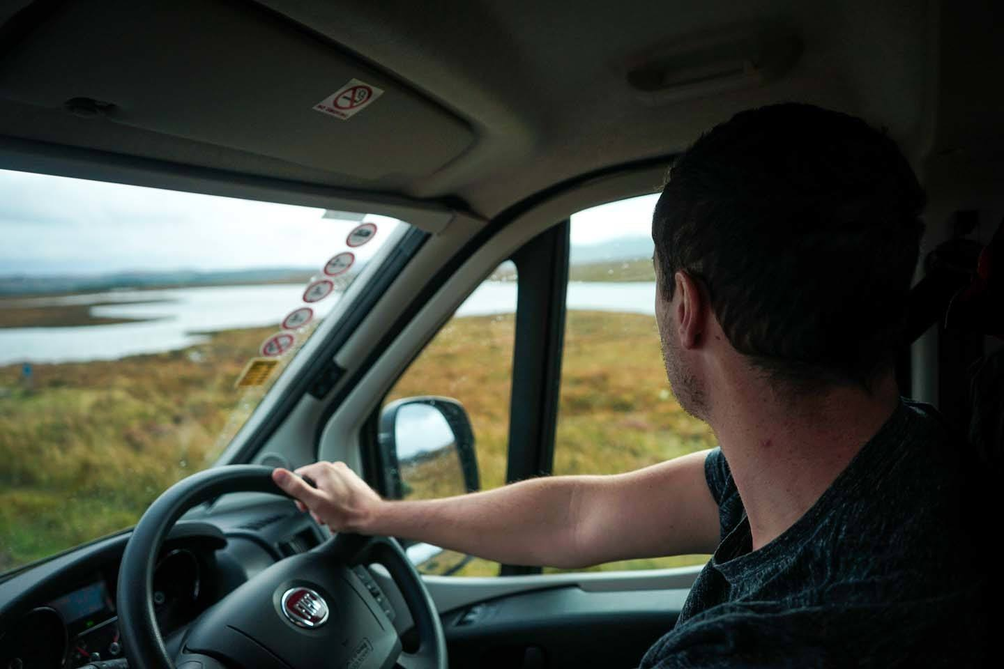 Man driving North Coast 500 Scotland