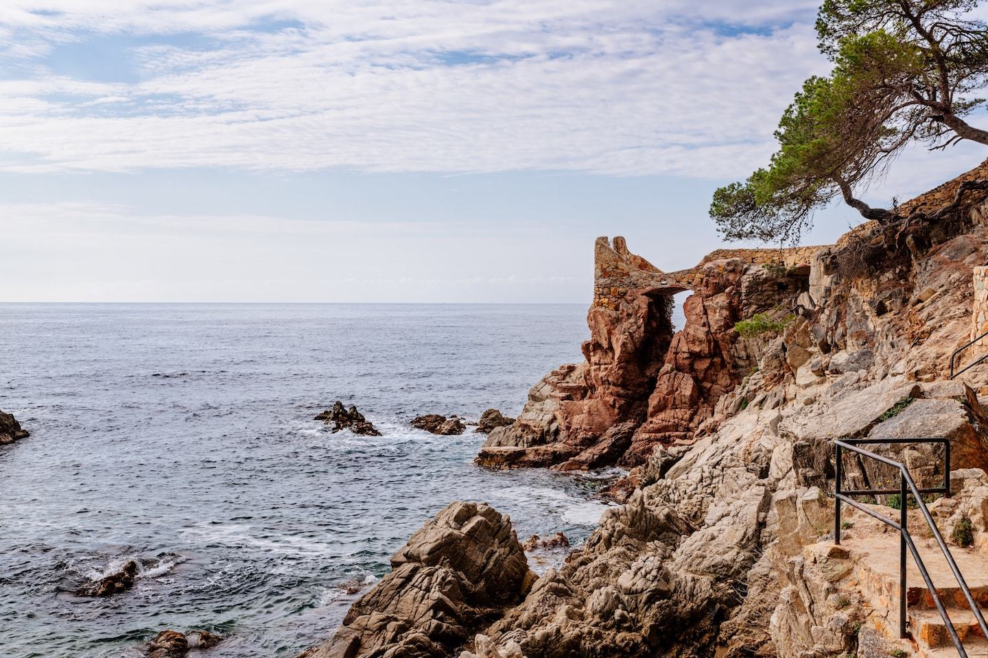rocky hiking path along the sea in costa brava spain