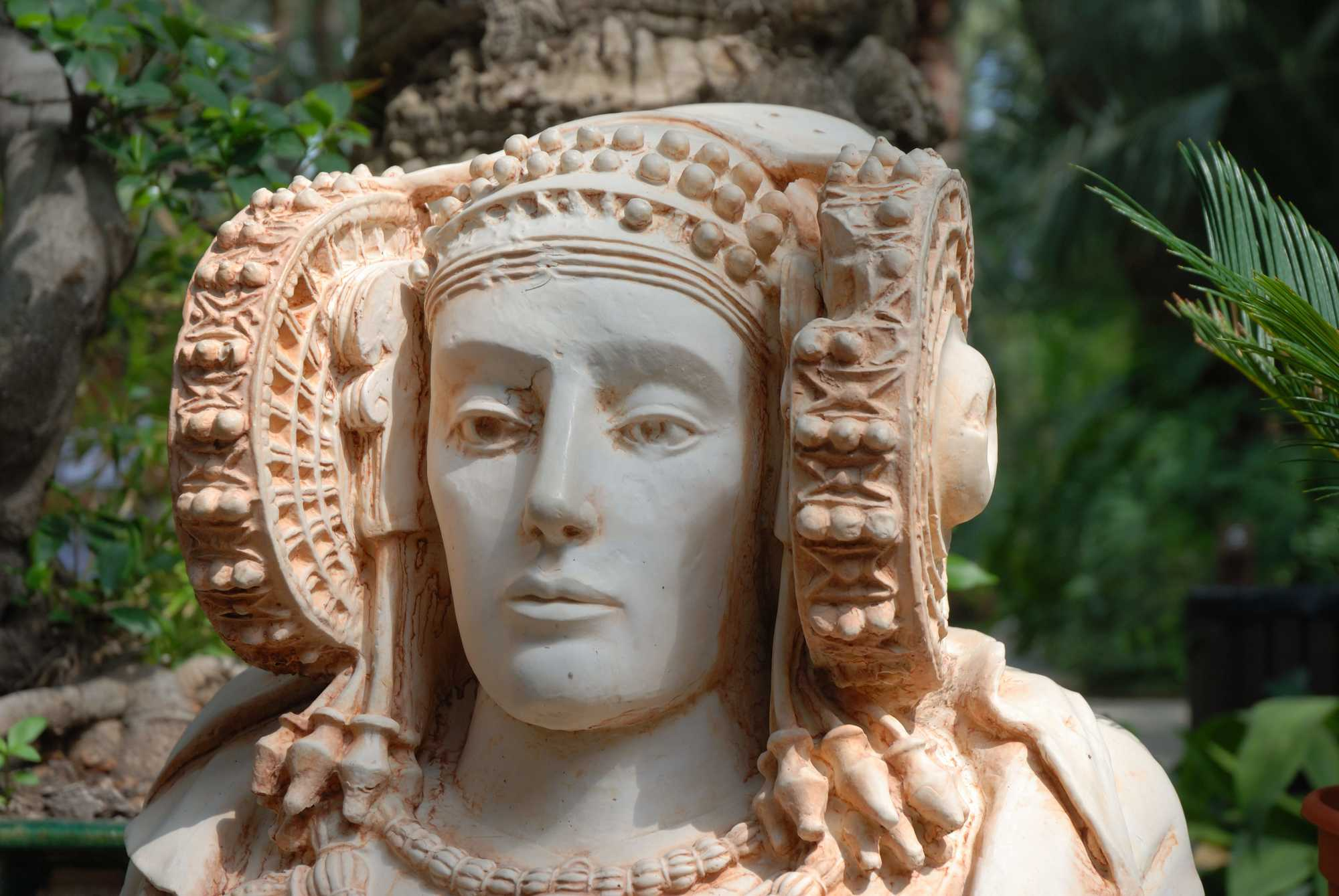 very detailed bust of a lady in white stone