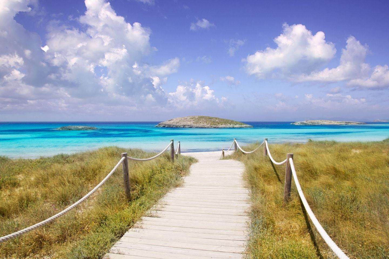 boardwalk to bright blue water on beach