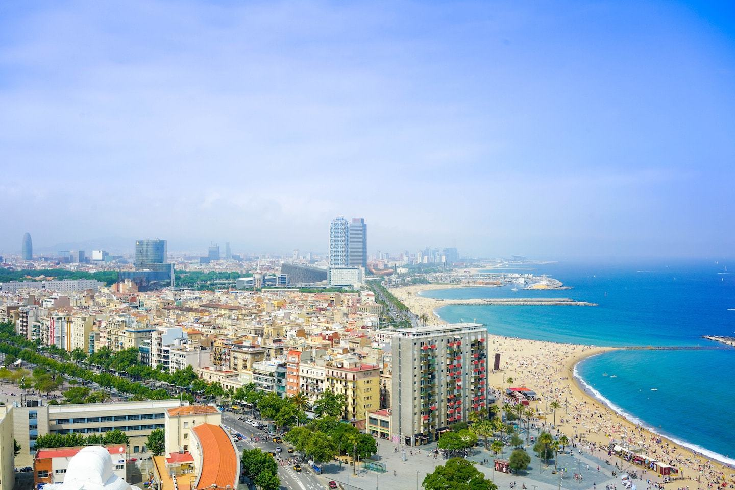 aerial view of city with beach and ocean in spain