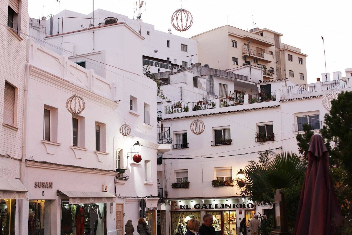 white houses and shops in marbella spain