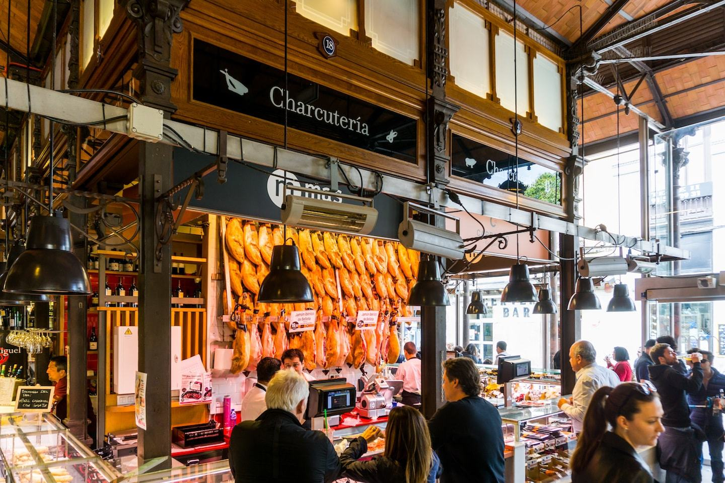 charcuterie counter at market in spain serving meat