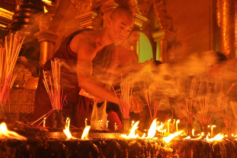 monk lighting candles