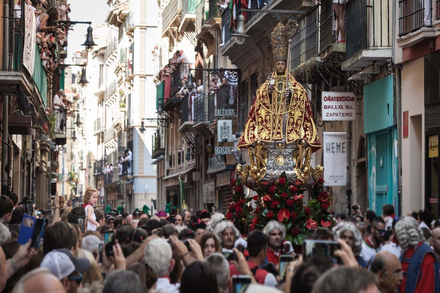 crowded street during festival in Spain