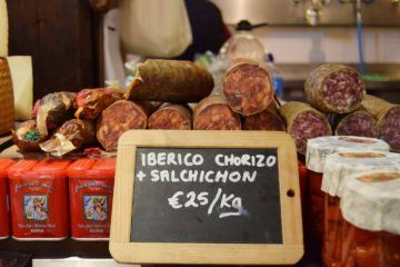 different types of spanish sausage being offered for 25 euros per kg