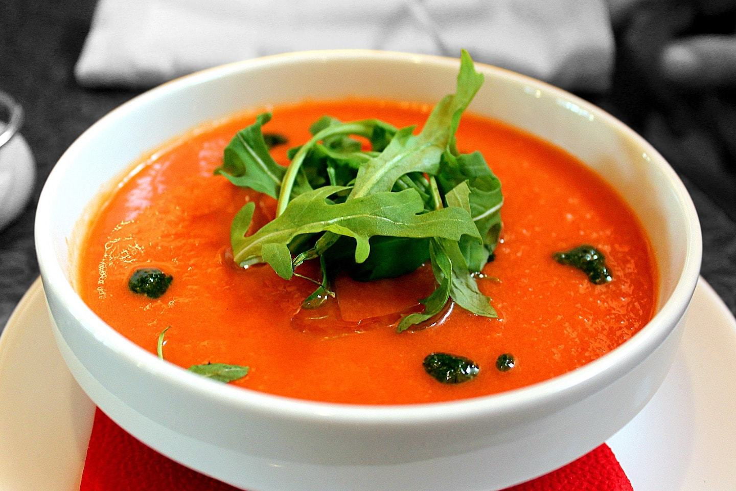 tomato soup with arugula garnish