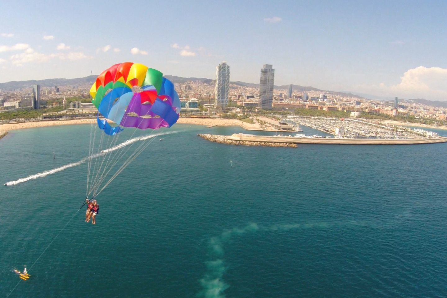 aerial view of parasailing in barcelona