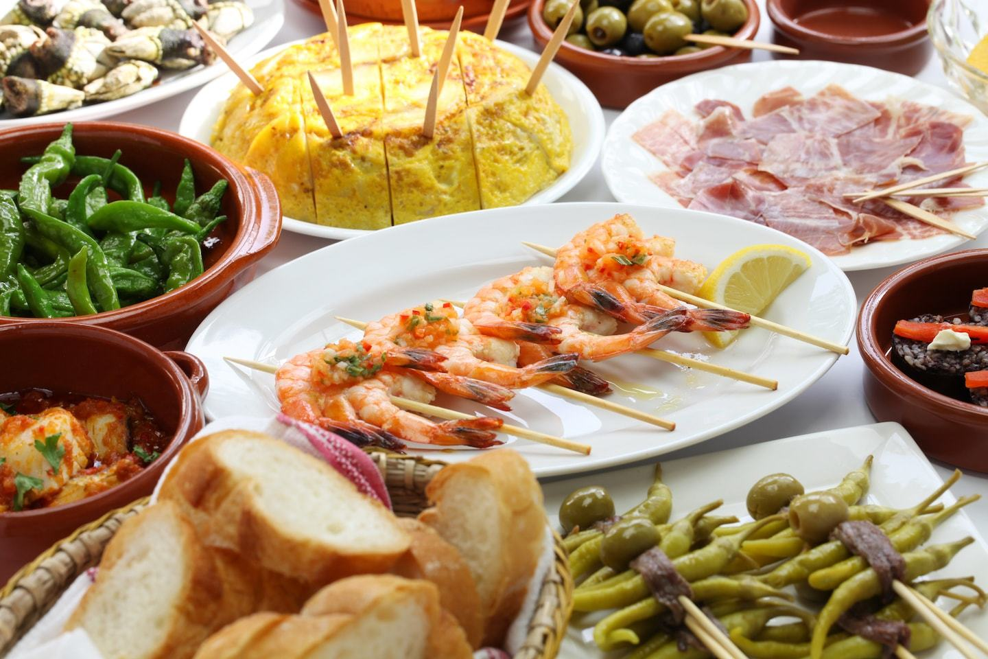 spread of different tapas dishes in spain
