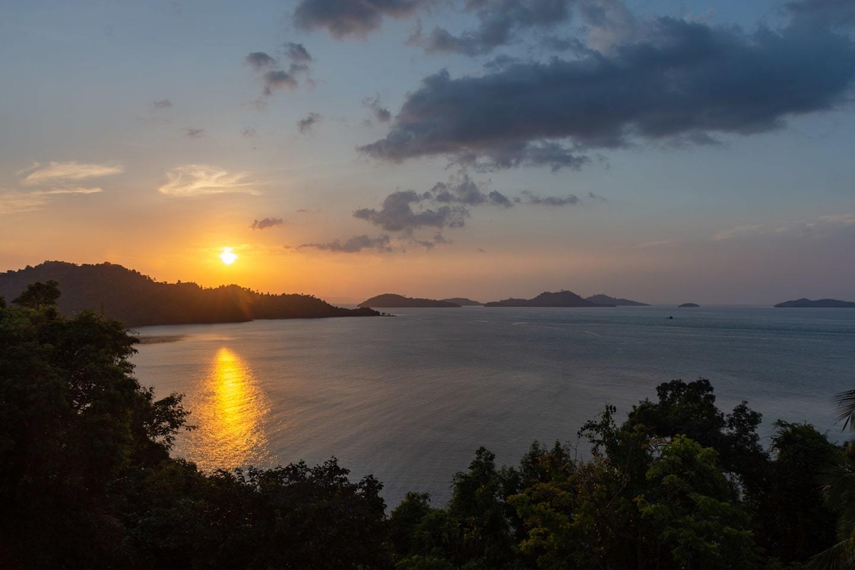 sunset over islands in myanmar