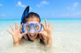 girl smiling, wearing a dive mask