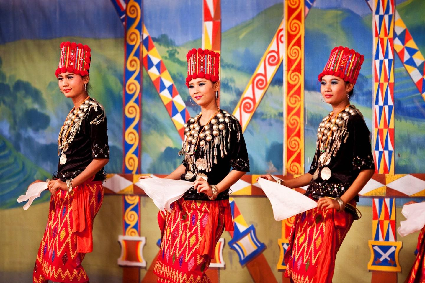 Burmese women dressed up and putting on traditional dance