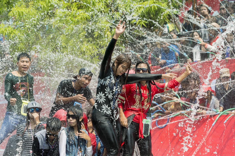 people throwing water on girl dancing in myanmar
