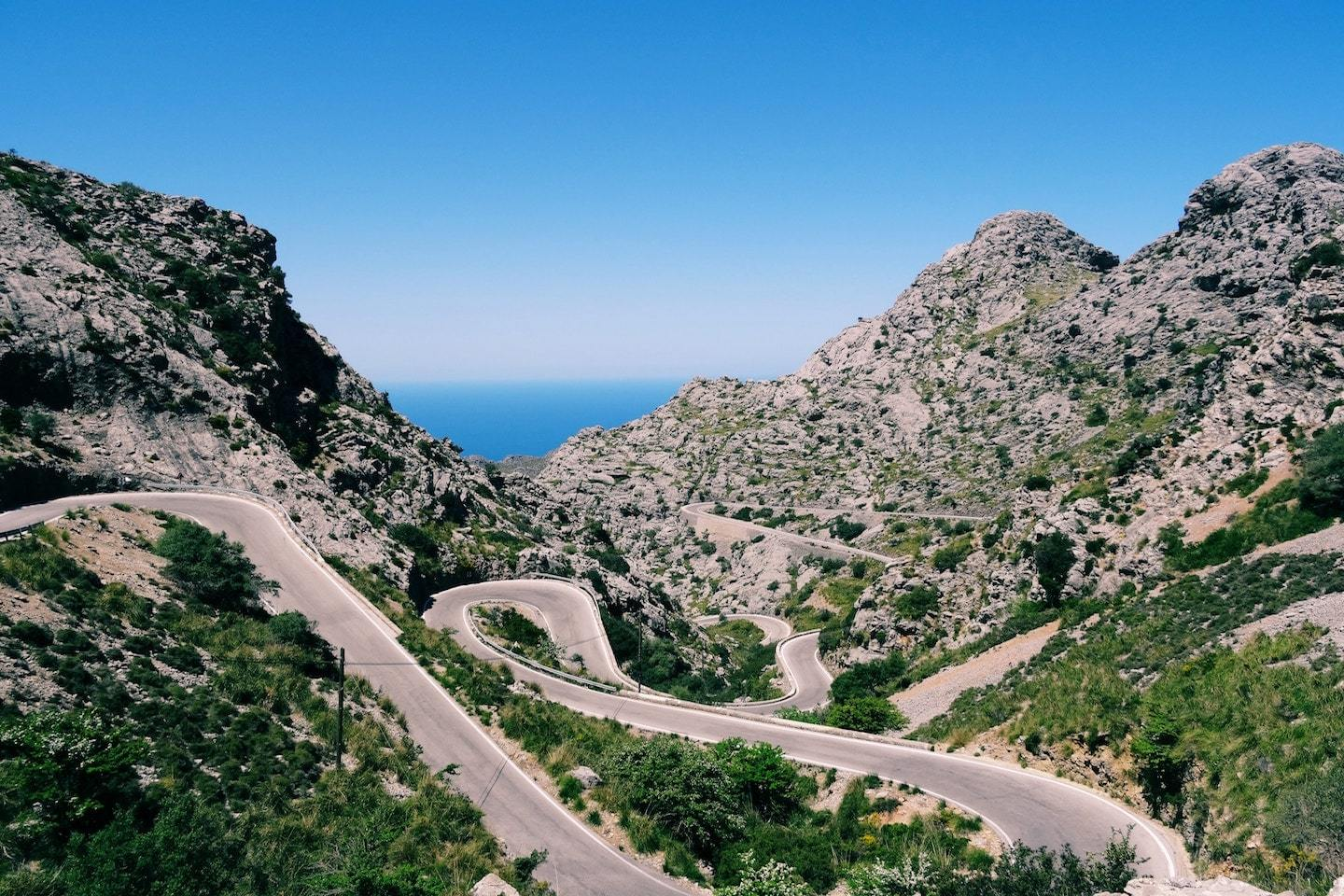 winding road going through mountains in spain