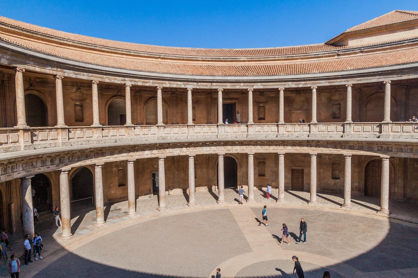 circular structure with pillars and openings around a central courtyard