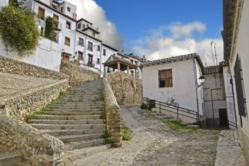 stone steps and buildings in front of blue sky