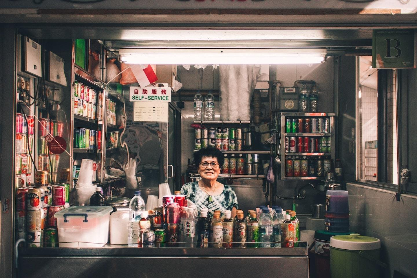 woman sitting in metal convenience store