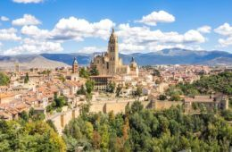 aerial view of Segovia with large church sticking out and blue sky